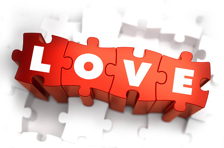 Love - Text on Red Puzzles with White Background and Selective Focus.